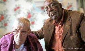Elderly men looking into camera