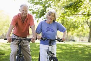 Elderly couple on bikes